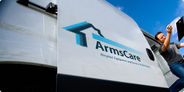 A friendly driver delivers medical equipment in an ArmsCare Van